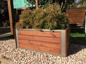 Wooden-flower-box-with-green-terrace-model-555x417
